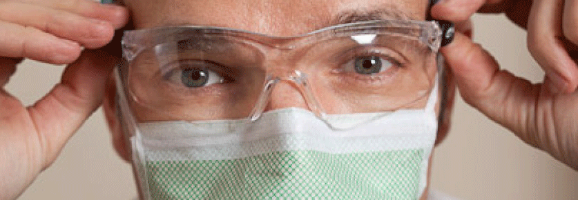 Surgeon putting glasses on